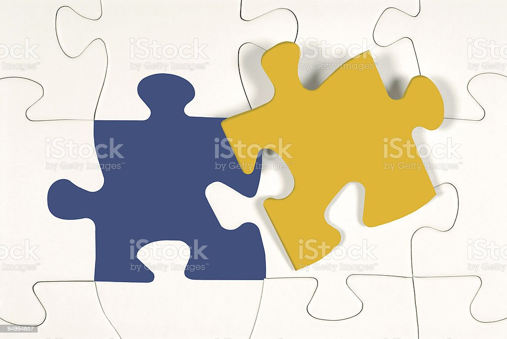 Yellow jigsaw piece against white royalty-free stock photo