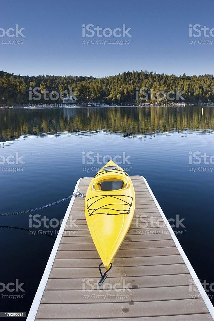 yellow kayak sits on a dock at Lake Arrowhead royalty-free stock photo