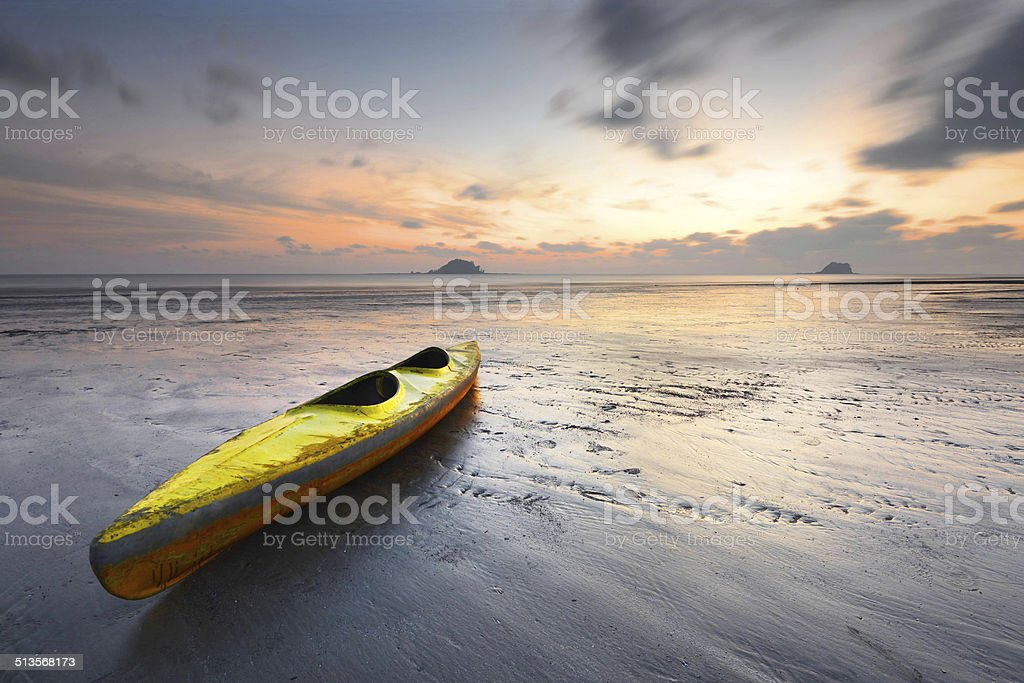 yellow kayak with moving fast clouds stock photo
