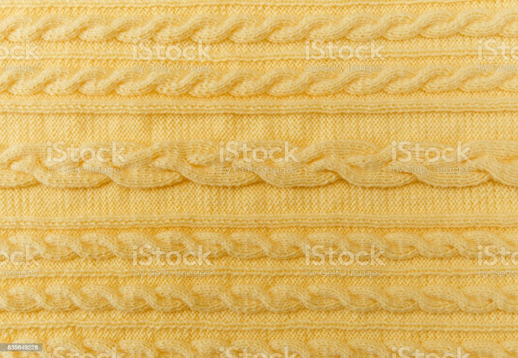 Yellow Knitted Background with Pattern and Braids.Hand Made;Fancywork stock photo