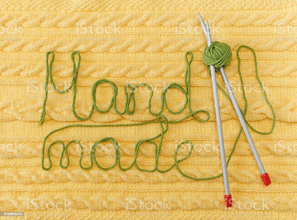 Yellow Knitted Background.Pattern,Braids;Knitting Needle.Hand Made stock photo