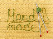 Yellow Knitted Background.Pattern,Braids;Knitting Needle.Hand Made