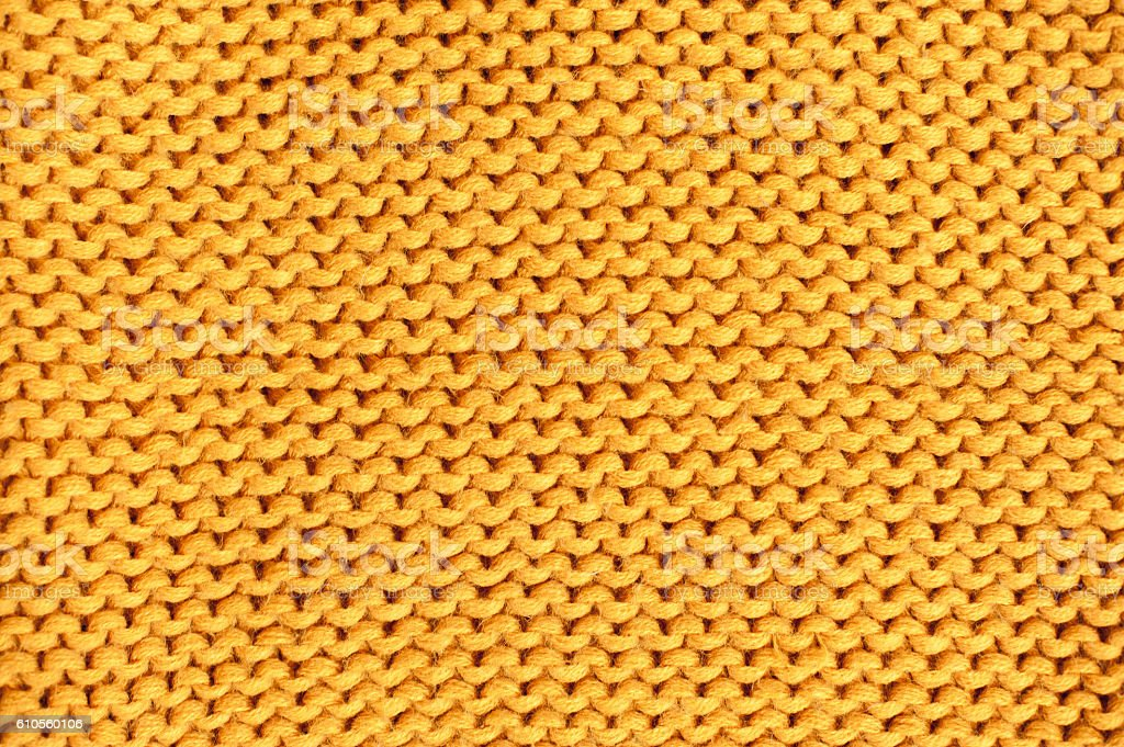 Yellow knitted texture. Wool yarn in knitting background vector art illustration