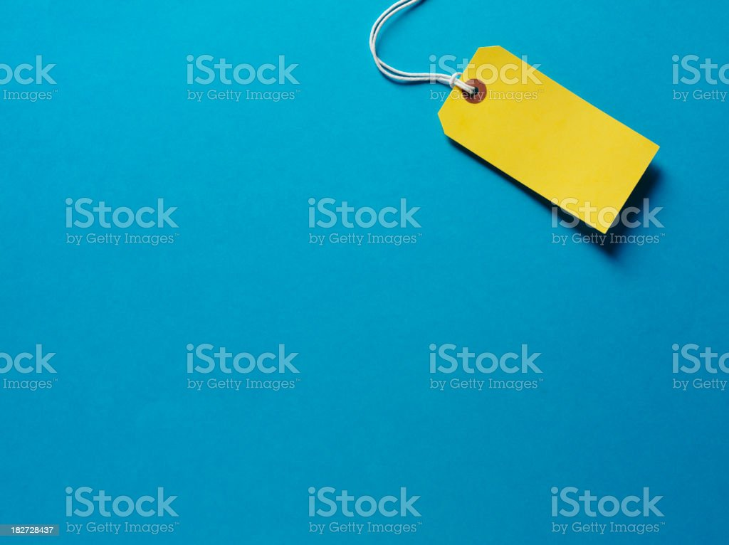 Yellow Label on a Blue Background stock photo