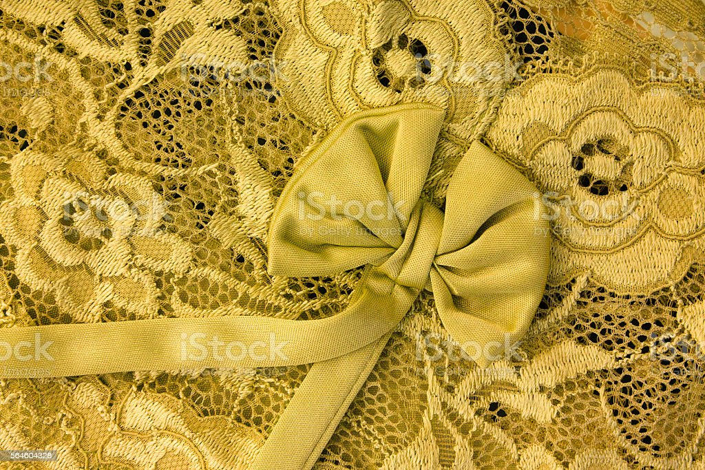 Yellow lace with bow stock photo
