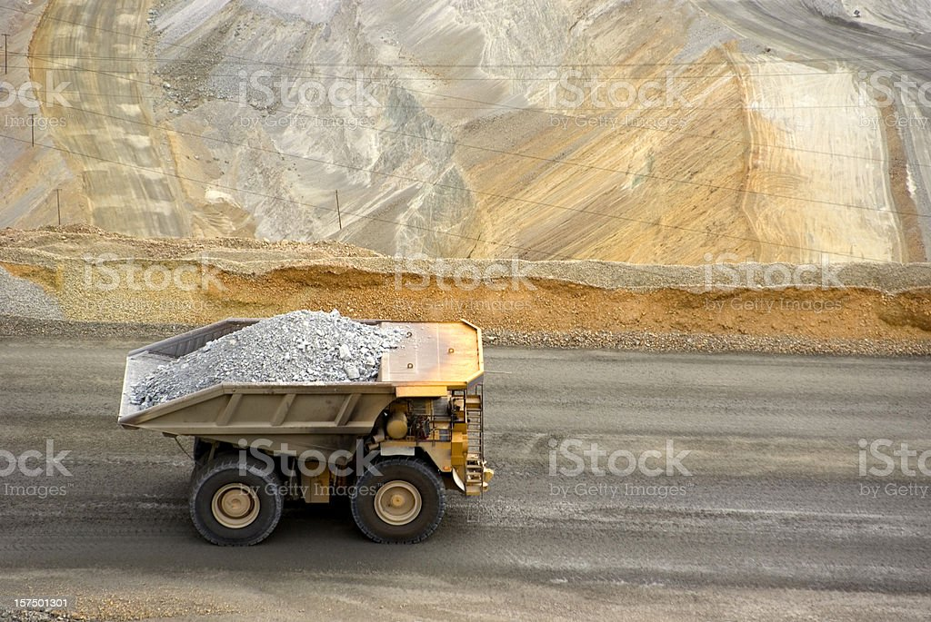 Yellow large dump truck in Utah copper mine seen from above stock photo