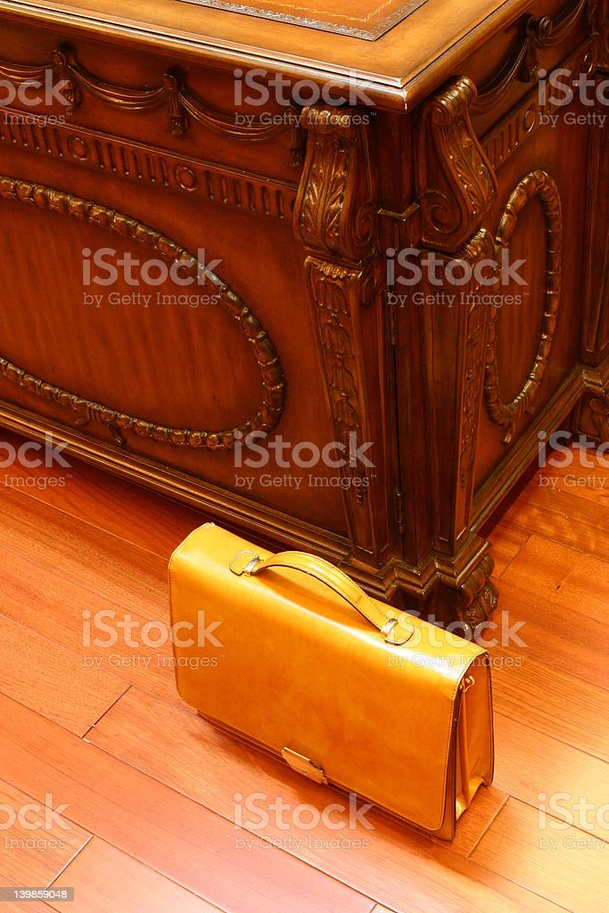 yellow leather briefcase in office royalty-free stock photo