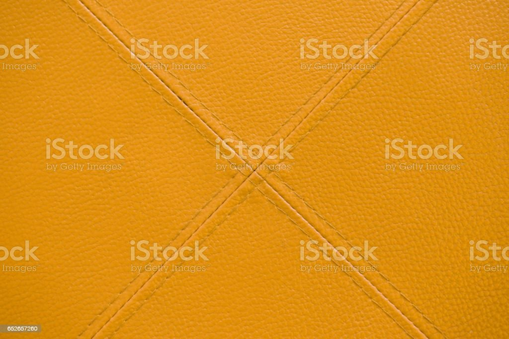 yellow leather with stitch texture and crosswise  symbol stock photo