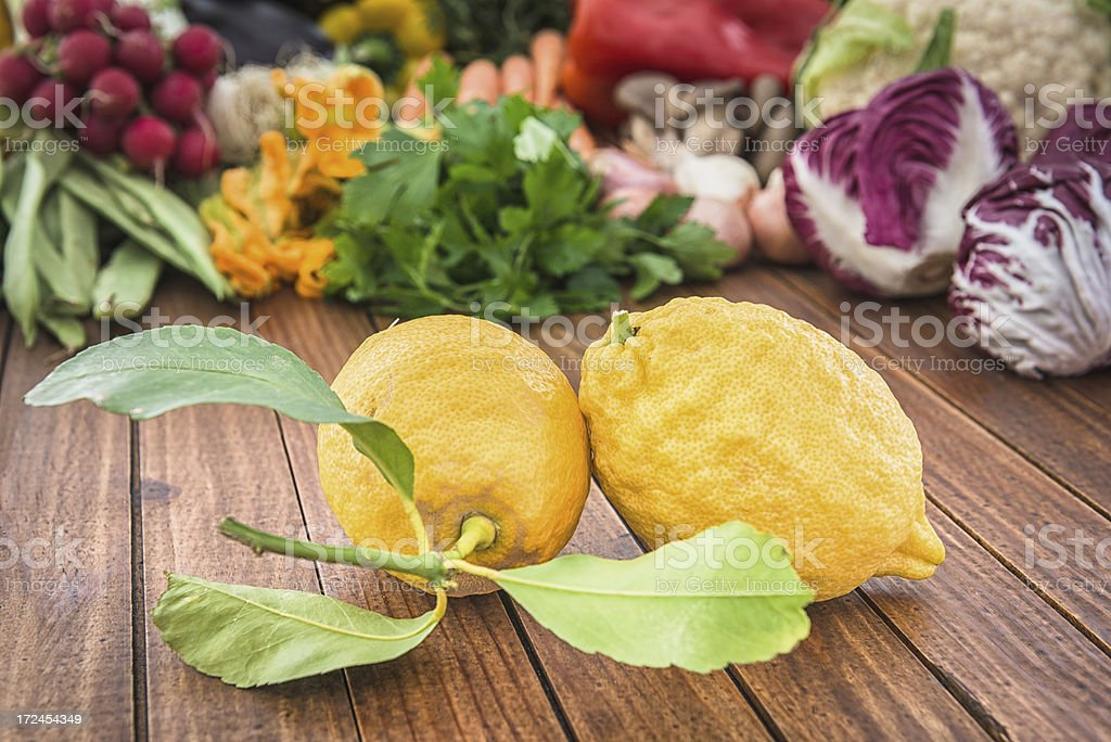 yellow lemon on wood plank with others vegeables royalty-free stock photo
