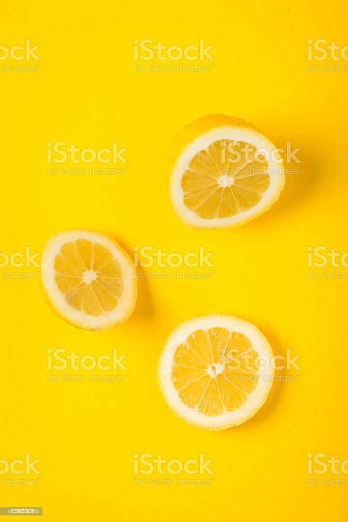 Yellow lemon on yellow paper background, minimalist still life stock photo