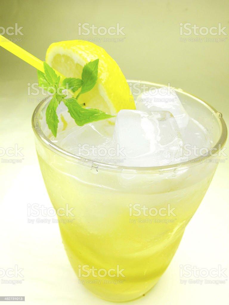 yellow lemonade with lemon and ice royalty-free stock photo