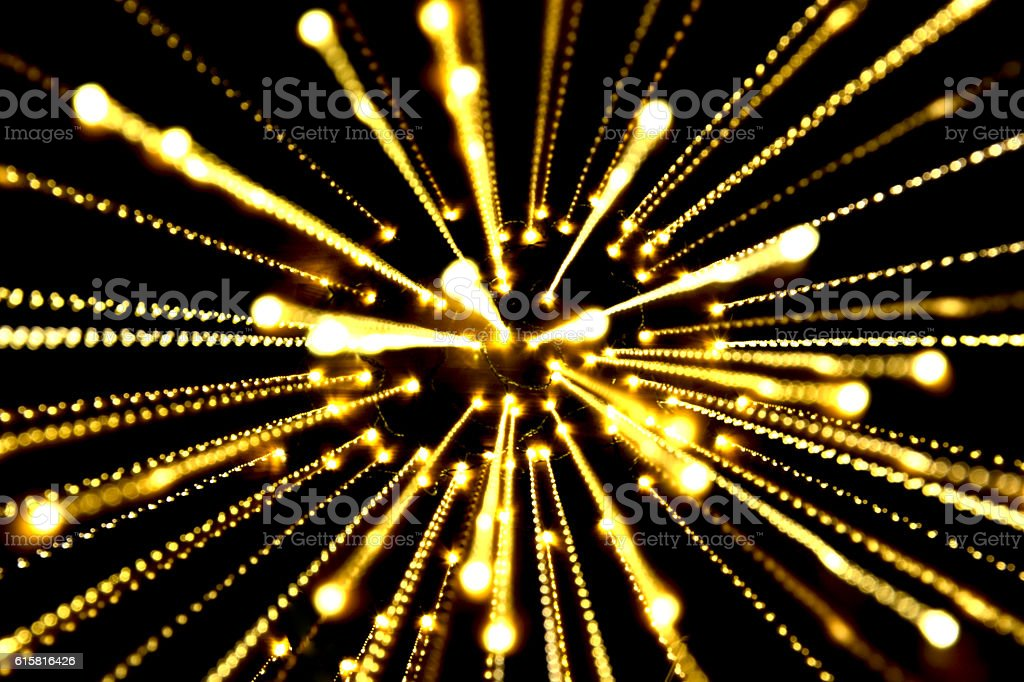 yellow light, long exposure ,bombs from center with black background royalty-free stock photo