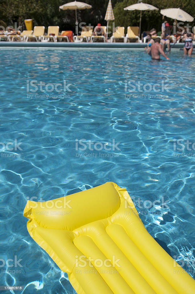 Yellow Lilo Resort Pool royalty-free stock photo