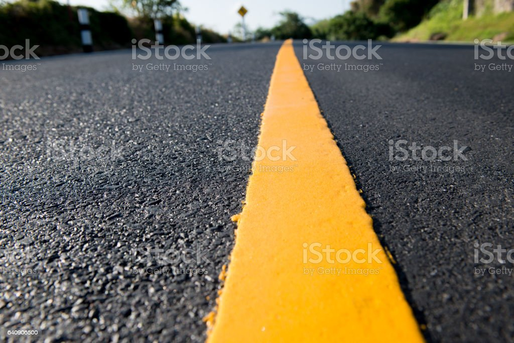 Yellow line on the new road stock photo