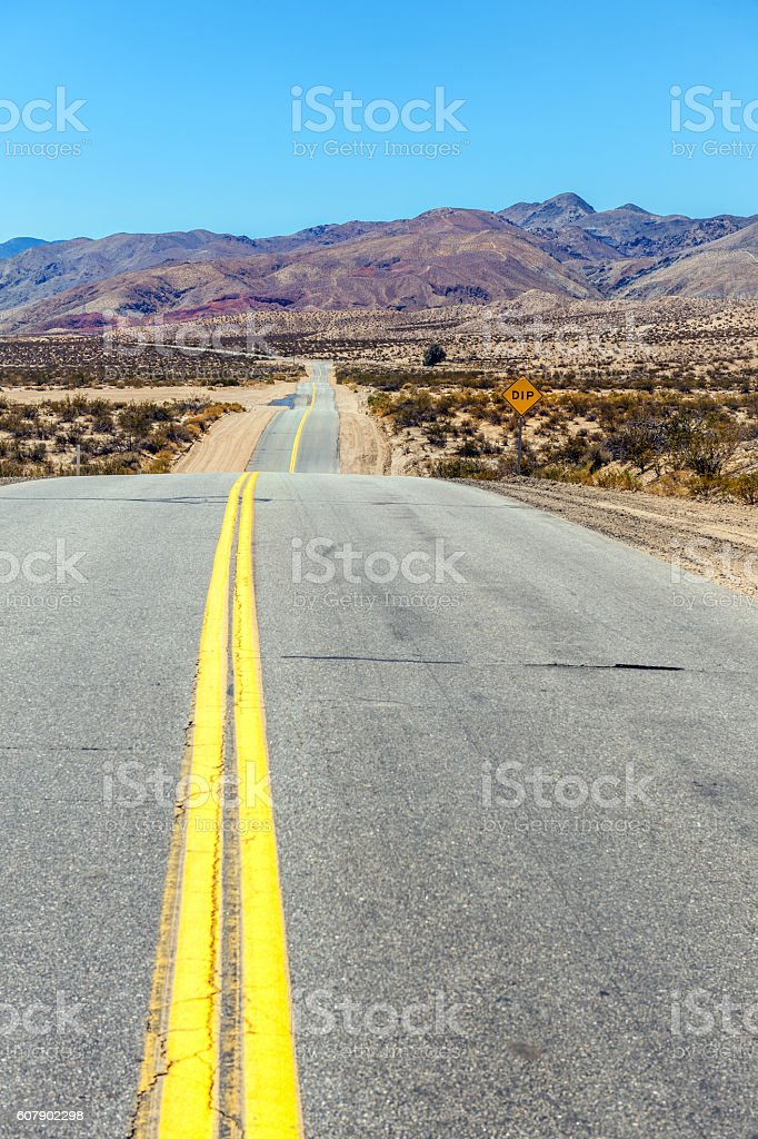 Yellow line, wavy road Death Valley,  California, USA. stock photo
