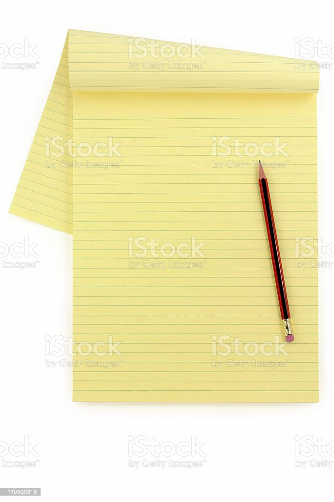 yellow lined paper and pencil stock photo