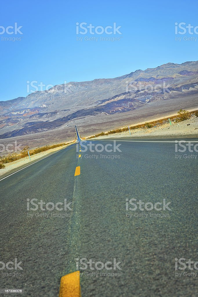Yellow Lines on Daylight Pass Road Death Valley USA royalty-free stock photo