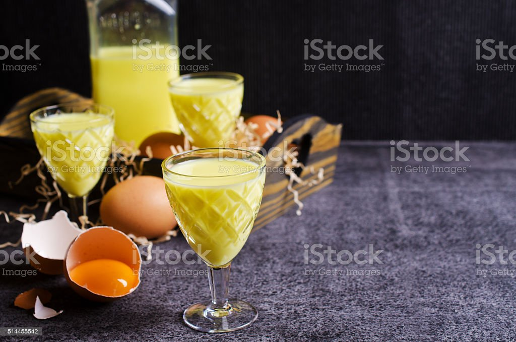 Yellow liquid in a glass stock photo