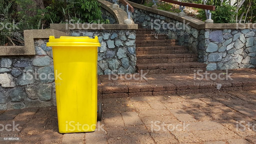Yellow litter garbage in park stock photo