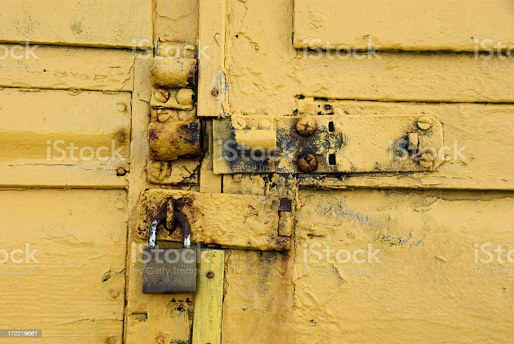 Yellow lock and latch royalty-free stock photo