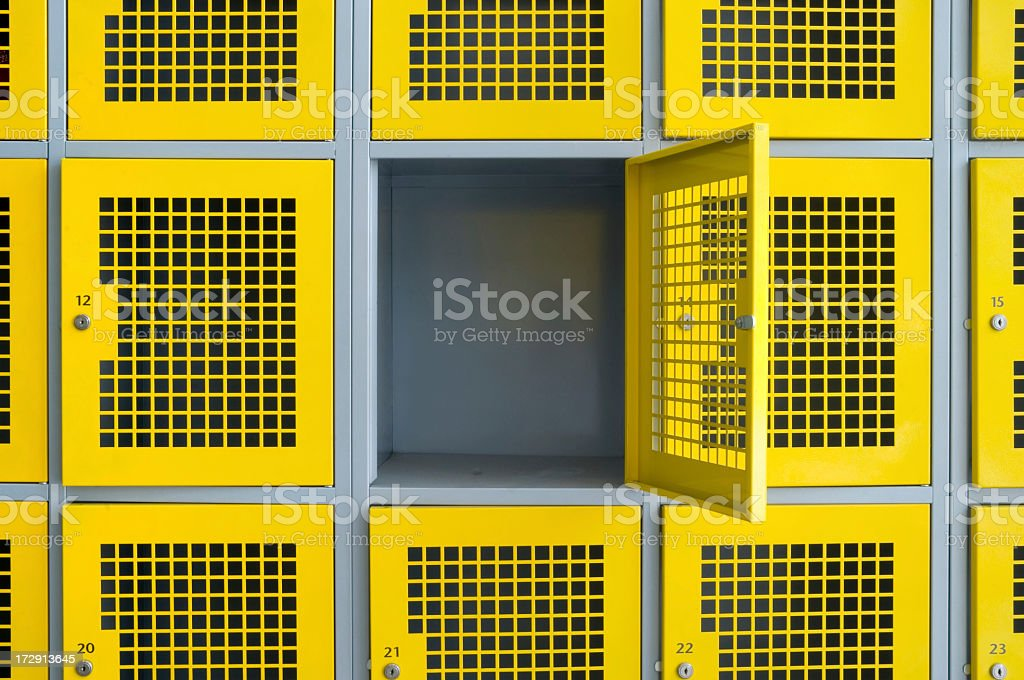 Yellow lockers with one open wide stock photo