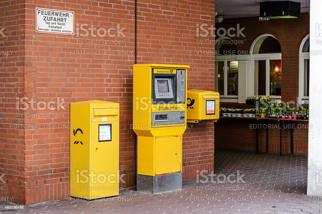 yellow mailboxes Deutsche Post stock photo