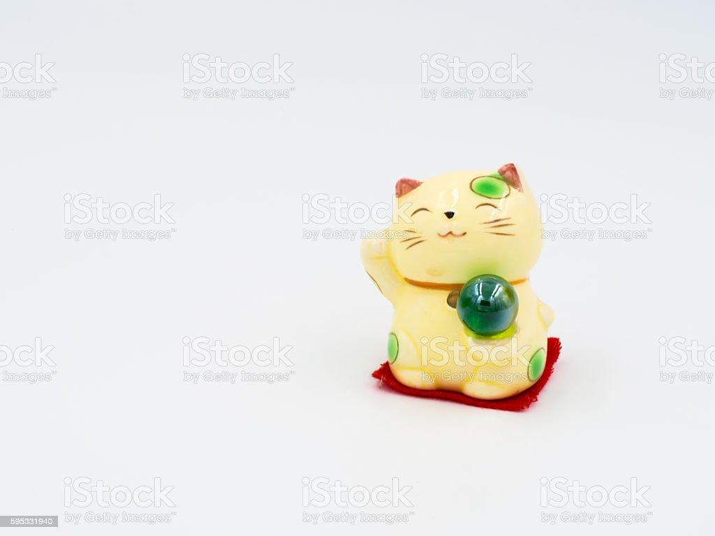 yellow Maneki-neko stock photo