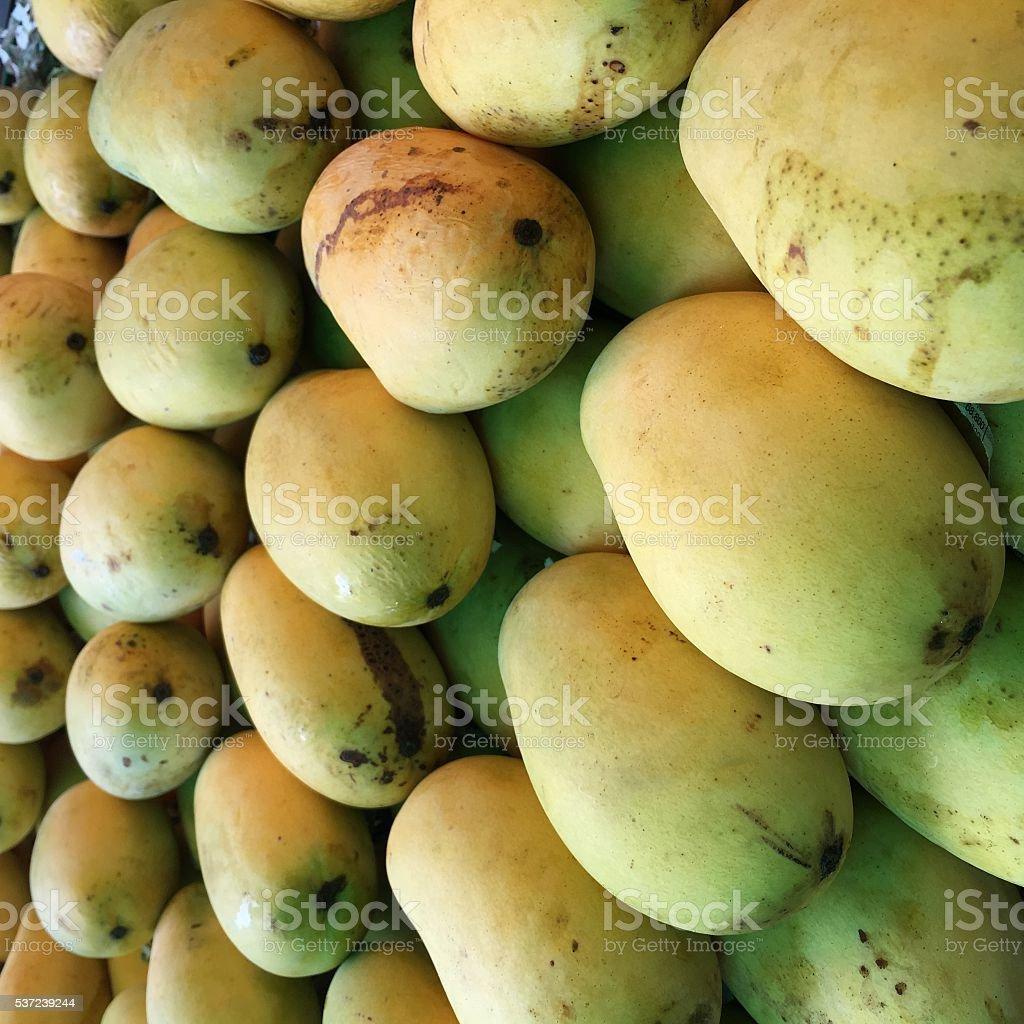yellow mango in market is mature ripe fully fledge stock photo