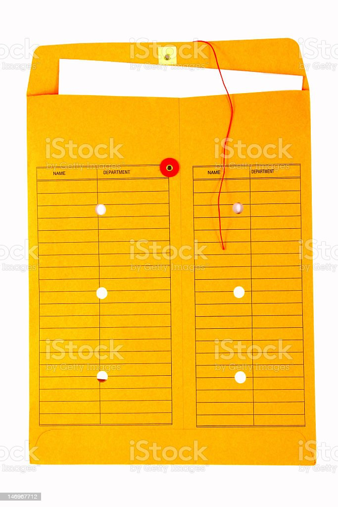 Yellow Manila envelope stuffed with papers stock photo