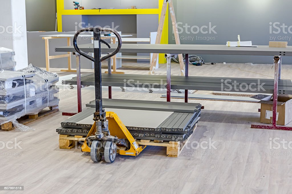 Yellow manually hydraulic forklift for pallet stacker, sack truc stock photo