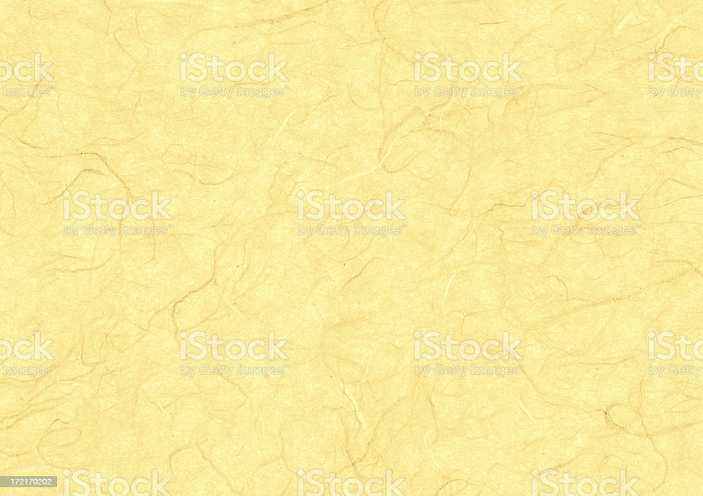 Yellow marbled art paper royalty-free stock photo