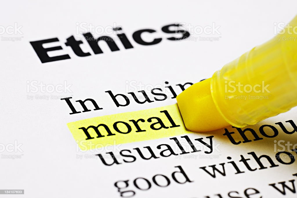 Yellow marker highlights 'moral' in Ethics document royalty-free stock photo