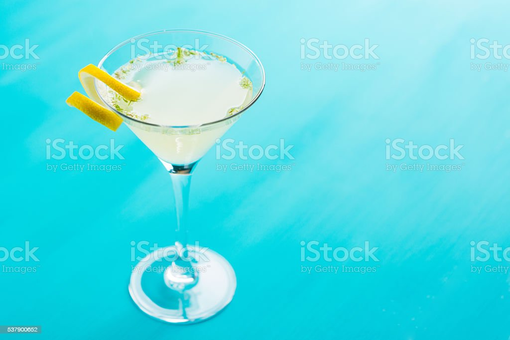 Yellow martini cocktail with lemon and mint stock photo