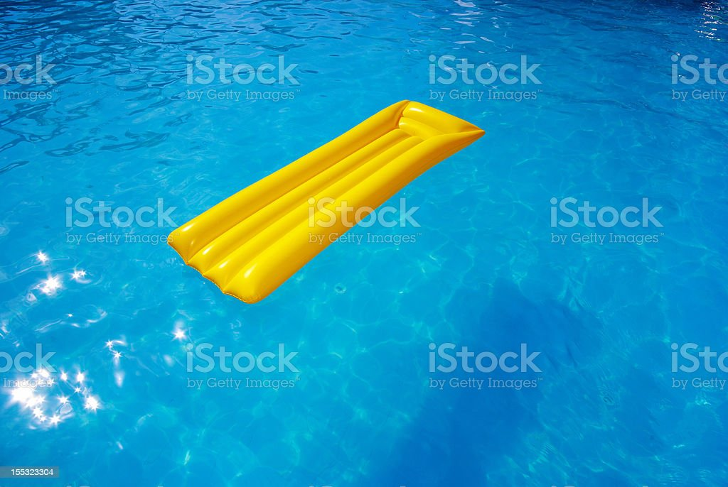 yellow mattress in the pool royalty-free stock photo