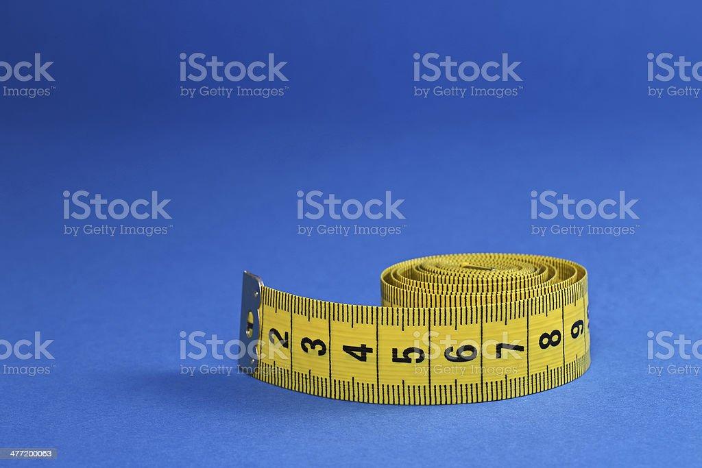 Yellow measure tape royalty-free stock photo