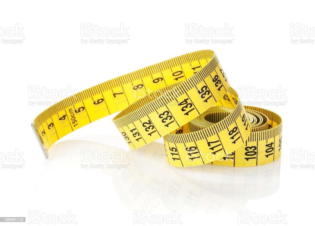 Yellow measure tape stock photo