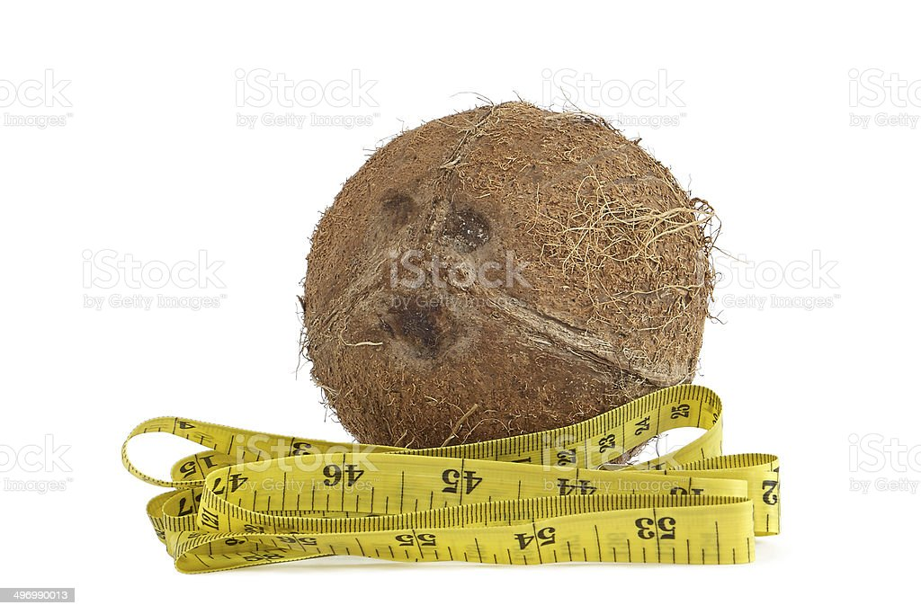 Yellow measuring tape and coconut stock photo