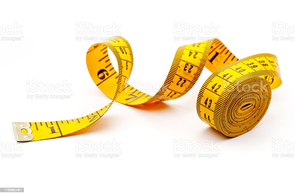 Yellow measuring tape on white background stock photo