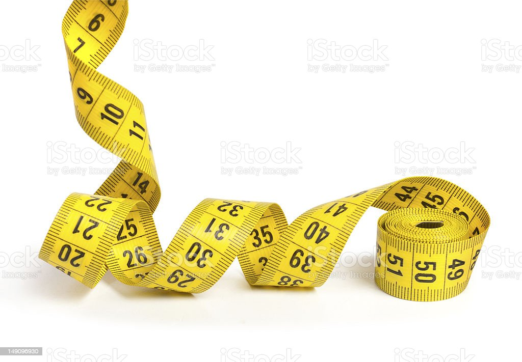 Yellow measuring tape rolled up on white background stock photo
