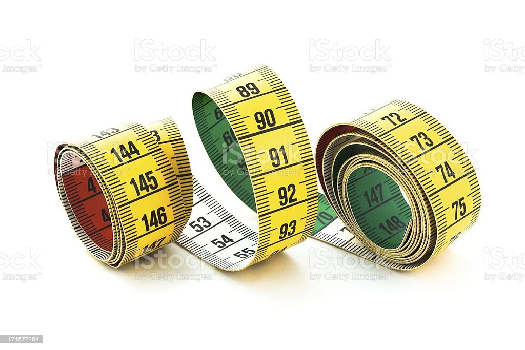 Yellow Measuring tape spiral looped on white royalty-free stock photo