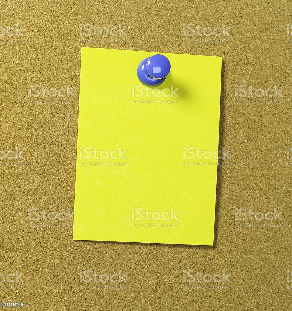Yellow memo on bulletin board royalty-free stock photo