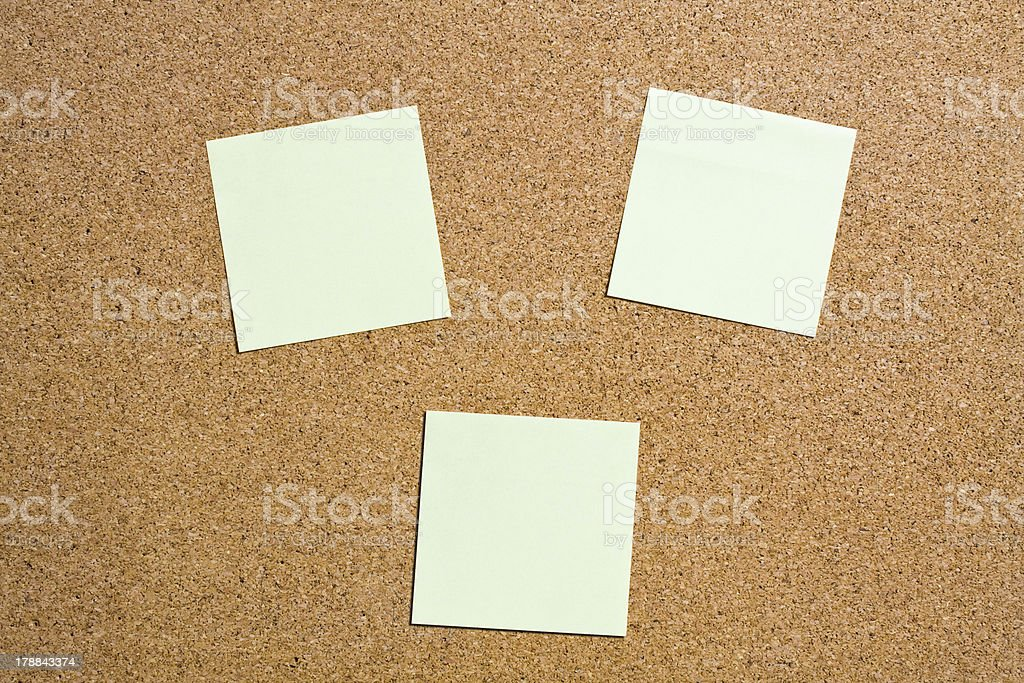 Yellow memo stick on cork board background royalty-free stock photo