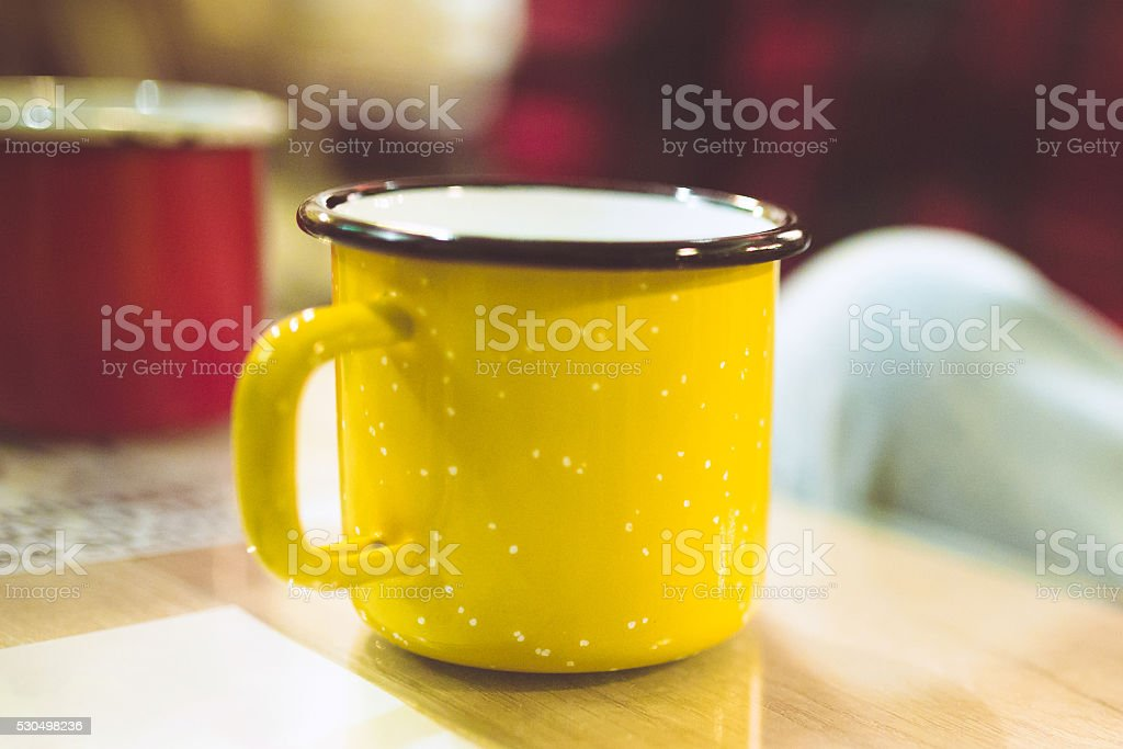 yellow metal cup stock photo