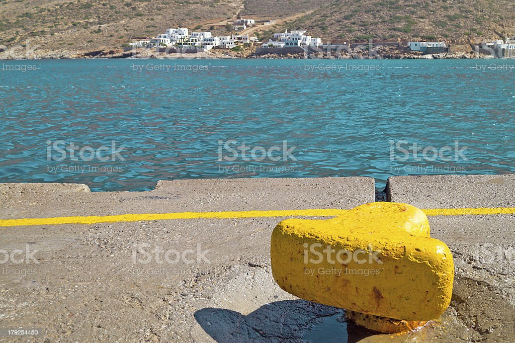 Yellow metal mooring at harbor on Sifnos island, Greece royalty-free stock photo
