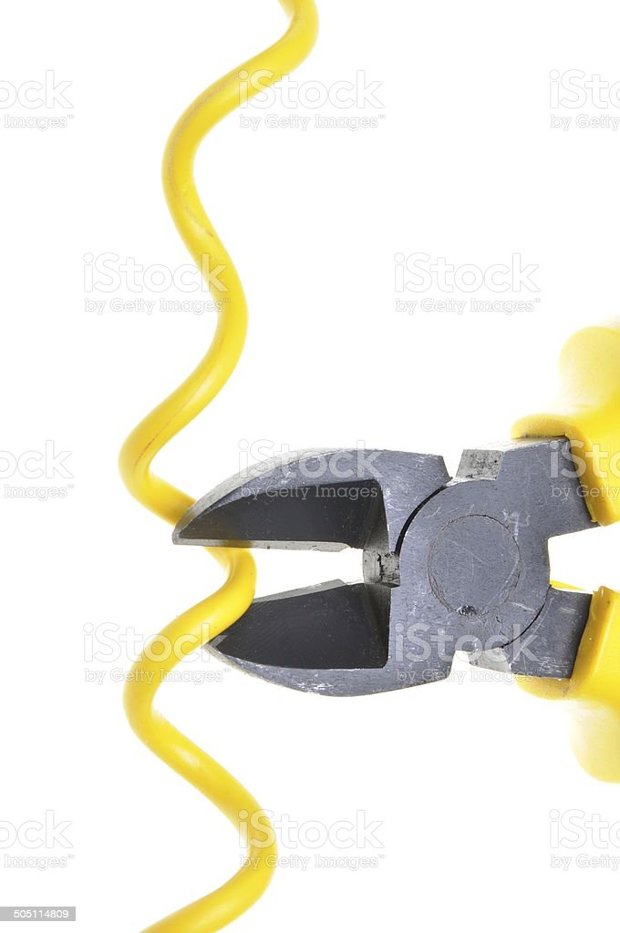 Yellow metal nippers and cable stock photo