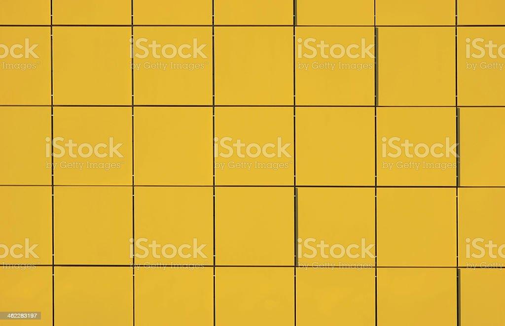 Yellow Metallic Facade Panel Background, horizontal detailed faceted pattern stock photo
