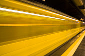 Yellow metro train in motion