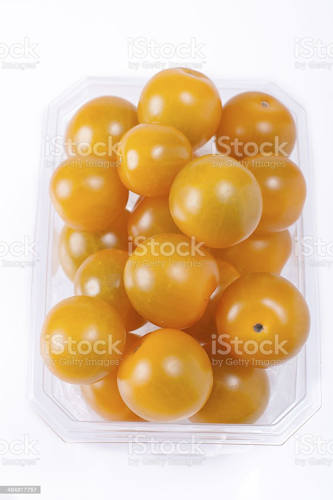 yellow mini tomatoes in packaging royalty-free stock photo