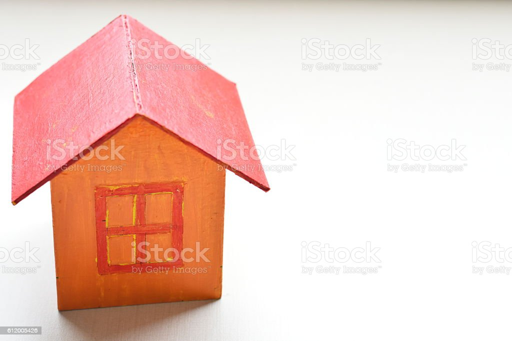 yellow model of house as symbol on white background stock photo