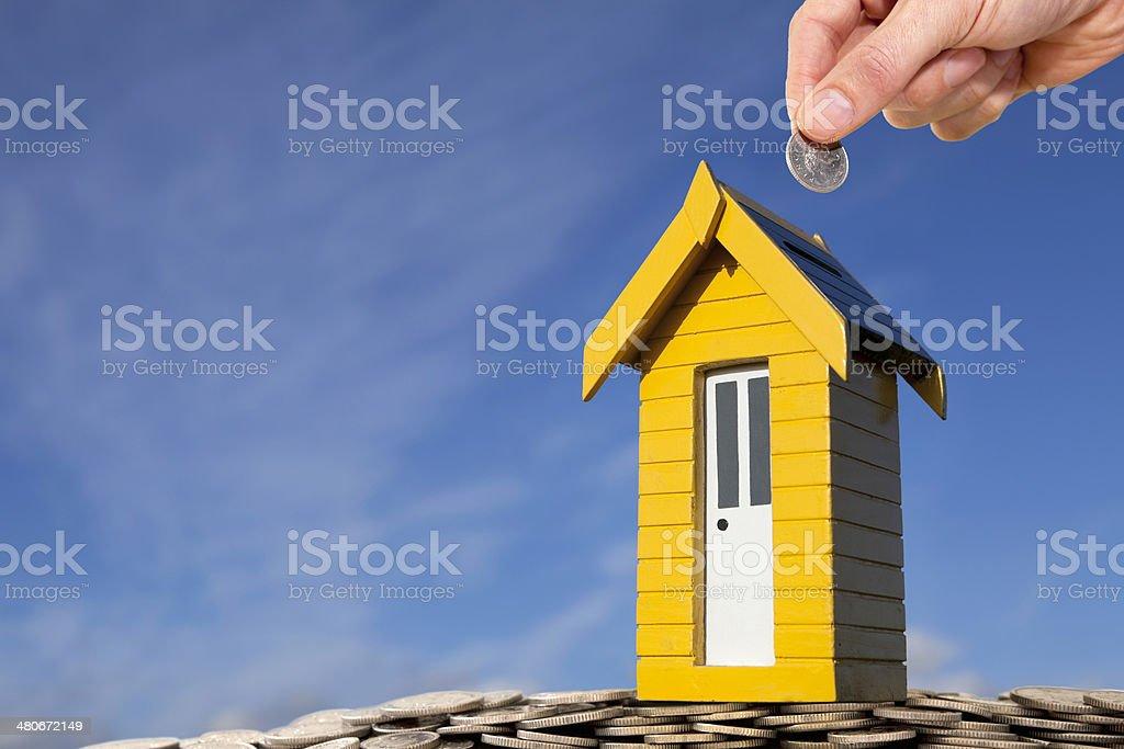 Yellow Money Box - Home Savings stock photo